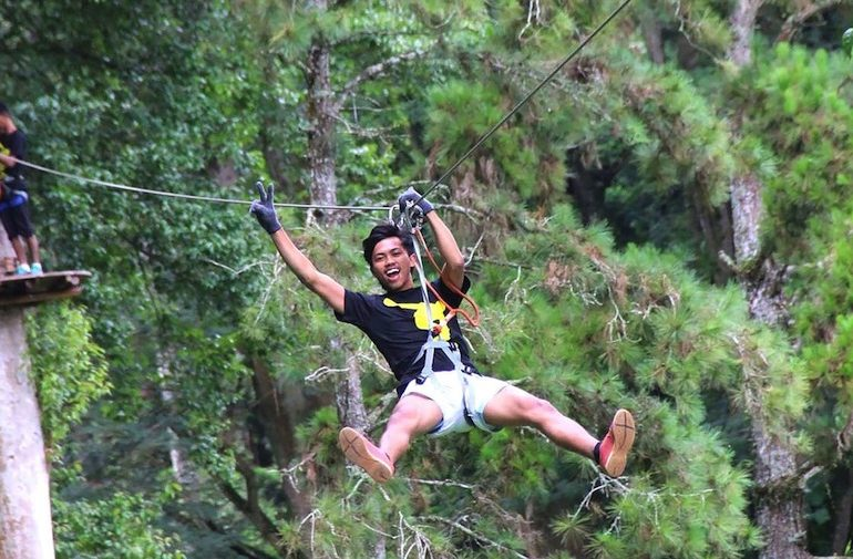 Down a zip line at Bali Treetop