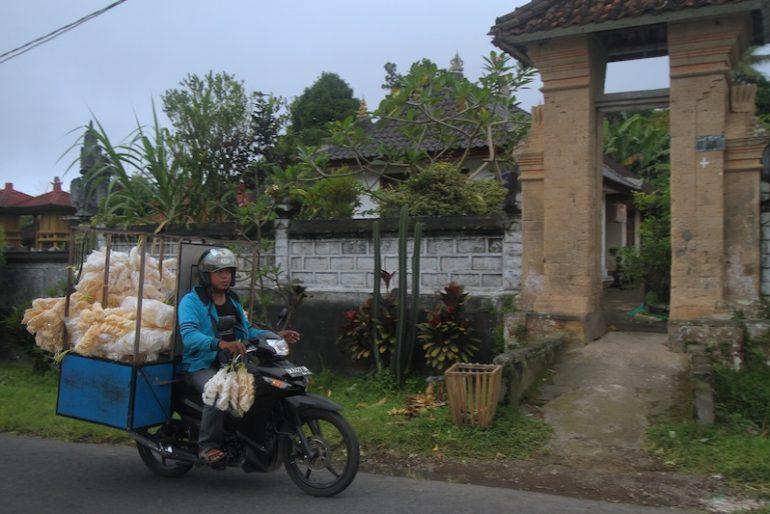 A cracker seller driving along the main road