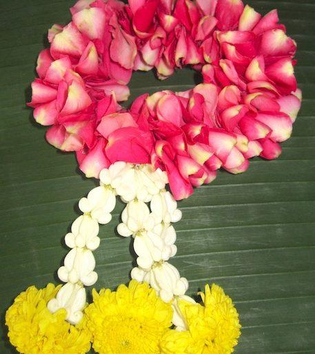 A Thai garland with Dok Rak flowers