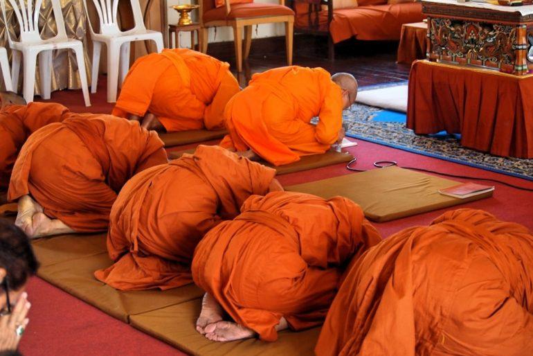 Bent in prayer