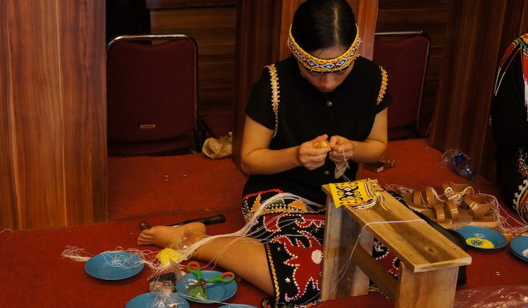 Local Dayak woman produces beads art