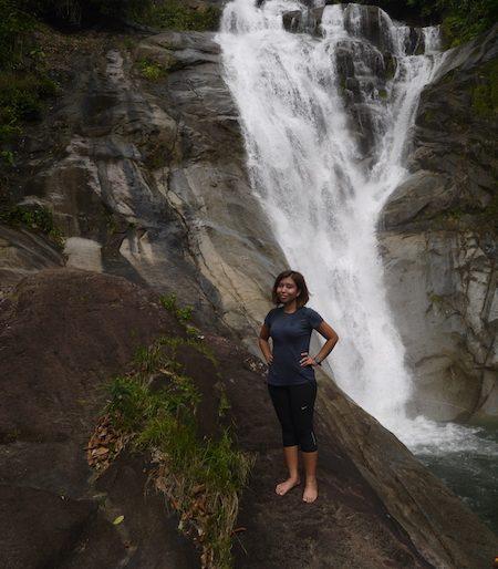 The writer enjoying the waterfall
