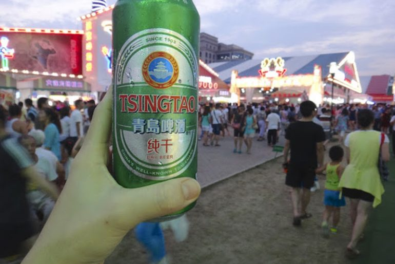 Cheering up with a can of Tsingtao Beer