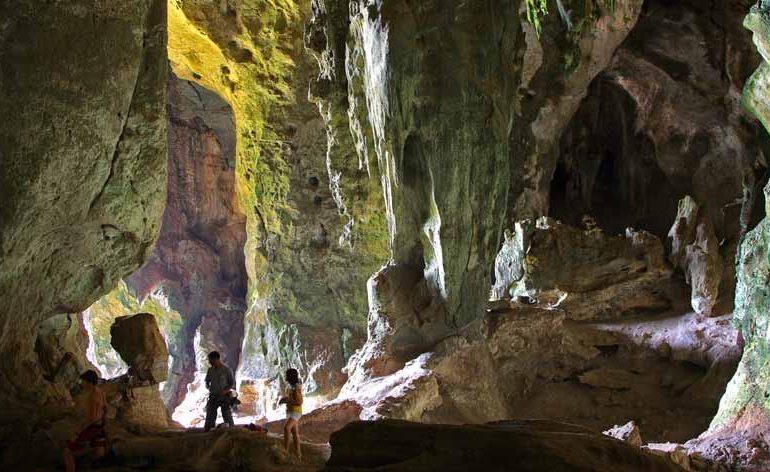 Mystical atmosphere inside ancient caves in Krabi