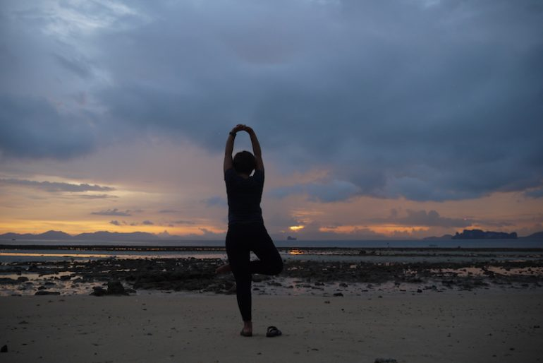 Me doing yoga at sunset