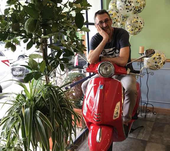 Fulvio Manini and his red Vespa, the Italian icon