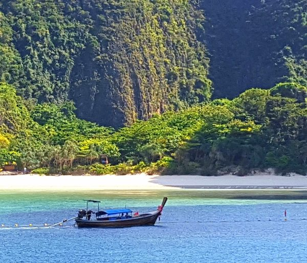 Traditional Longtail boat with an idyllic backdrop