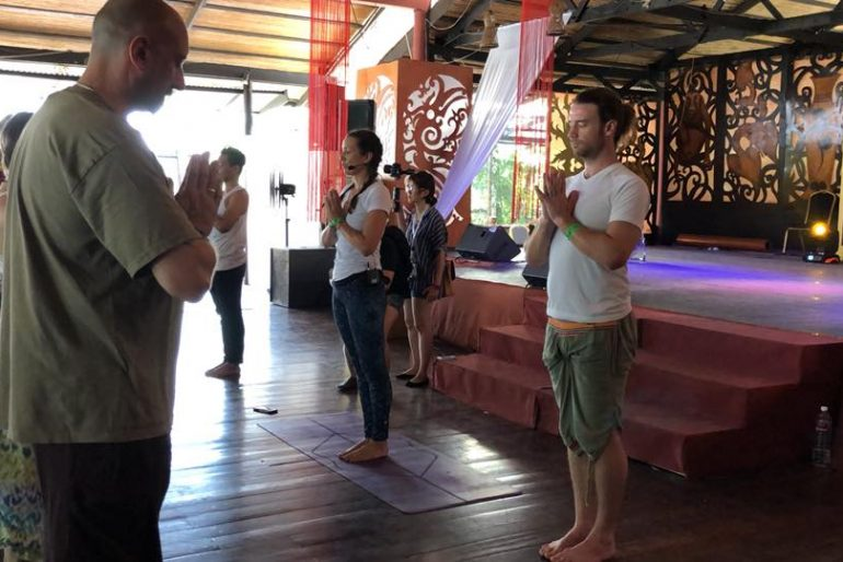 Louise and Rodrigoo teaching yoga at RWMF