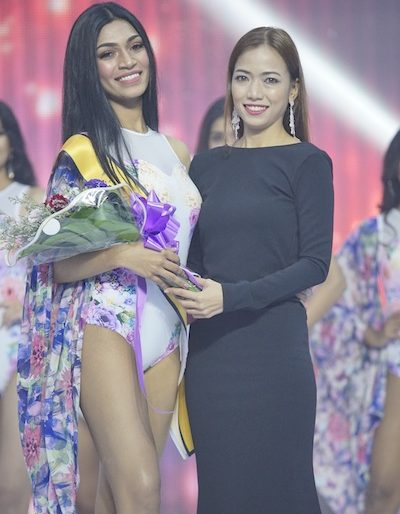 Best in Swimwear winner receiving her prize from Bikin Malaysia.