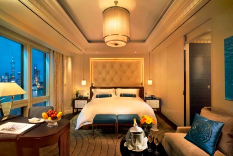 Deluxe River Rooms at The Peninsula Shanghai overlook the Huangpu River and dynamic Pudong skyline