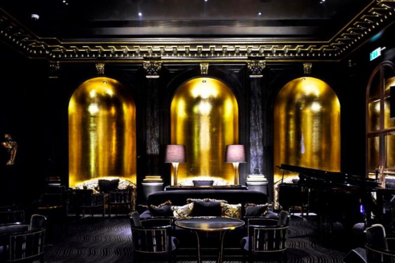 High drama at The Savoy's Beaufort Bar blends Art Deco patterns and colors with an English Edwardian backdrop