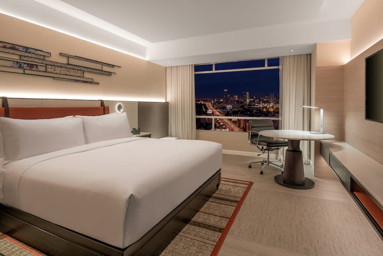 Admire views of vibrant Bangkok from the King Deluxe Room fitted with well-appointed amenities for today's frequent travellers