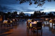Keinnara Loikaw eating by the pool at night