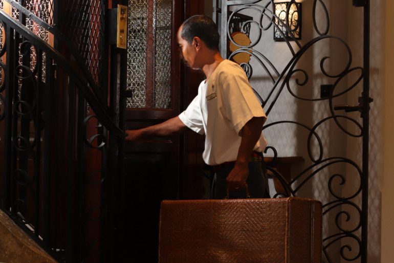 Raffles Grand Hotel d'Angkor's iconic teak and iron cage elevator, built in 1929 and lovingly preserved