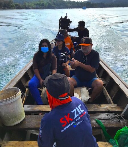 Our team on the long tail boat