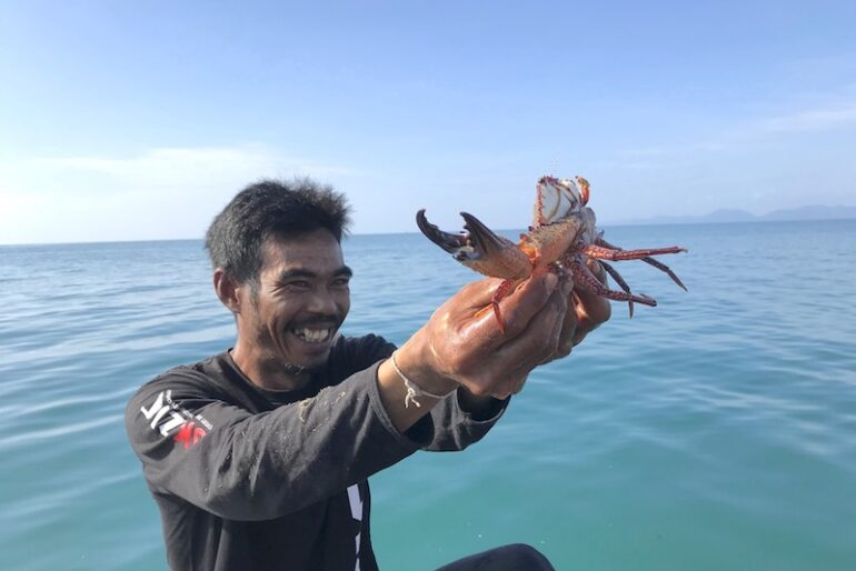 Cha's husband proudly shows us the best crab of the day