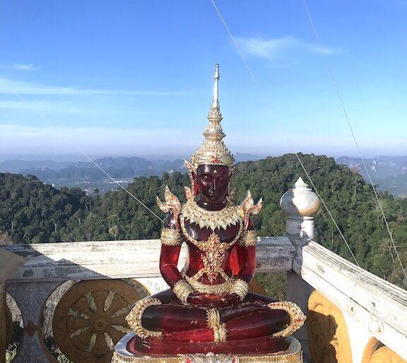 A red replica of the Emerald Buddha