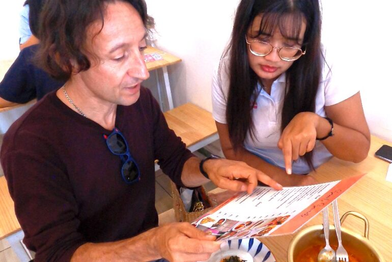 Nina and I looking at the menu