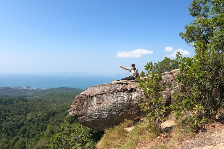 On a giant slab of rock overhanging the clifftop