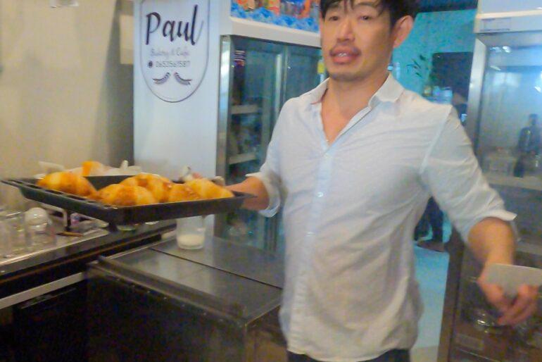 Paul bringing frashly-baked croissants to the showcase
