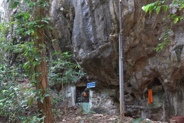 One of monk's cemented hles in the mountain where they spend some of their ascetic time